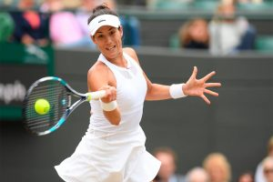 Muguruza golpea una derecha en Wimbledon